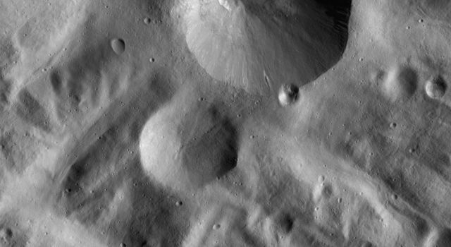 This image NASA's Dawn spacecraft shows is located in Vesta's Rheasilvia quadrangle, near Vesta's south pole. Severina crater has a fresh, sharp rim and a smaller, presumably younger, crater on its rim.