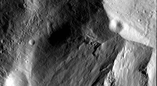 This image from NASA's Dawn spacecraft shows a close-up view of the wall of the Rheasilvia impact basin on asteroid Vesta.