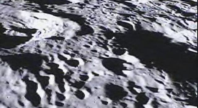 This image of the far side of the lunar surface, with Earth in the background, is of crater De Forest and was taken by NASA's MoonKAM system onboard the Ebb spacecraft.