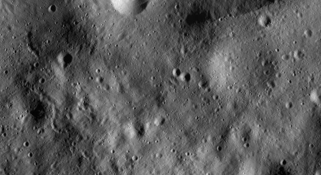 This image from NASA's Dawn spacecraft shows many linear and curvilinear grooves running roughly diagonally across asteroid Vesta's Gegania quadrangle.