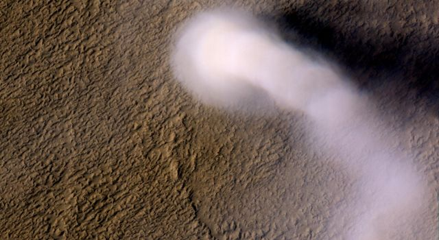 A Martian dust devil was captured winding its way along the Amazonis Planitia region of Northern Mars on March 14, 2012 NASA's Mars Reconnaissance Orbiter.