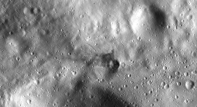 This image from NASA's Dawn spacecraft, located in asteroid Vesta's Urbinia quadrangle in the Vestan southern hemisphere, shows a small crater with ejecta made of dark material.