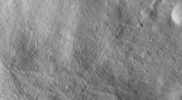 This image of asteroid Vesta from NASA's Dawn spacecraft shows a particularly smooth part of the giant asteroid's surface, likely covered in fine-grained regolith material.