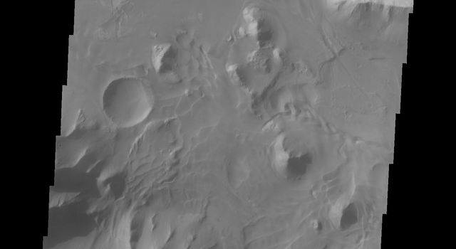 This image from NASA's 2001 Mars Odyssey spacecraft shows dune forms on the floor of Orson Welles Crater, an impact crater in the Coprates quadrangle named for the actor.