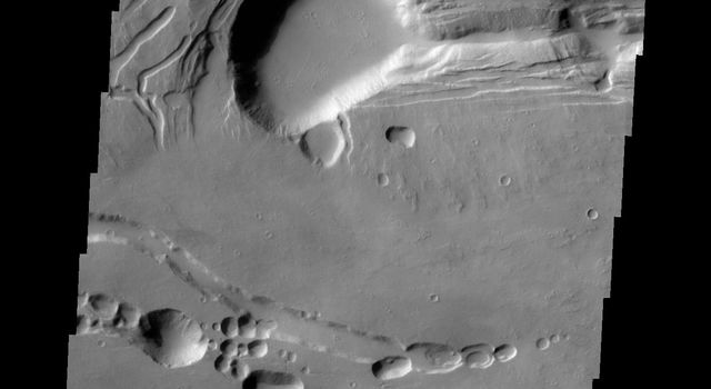 This image from NASA's 2001 Mars Odyssey spacecraft shows the complex collapse features on the southern flank of Ascraeus Mons.