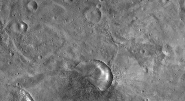 This image from NASA's Dawn spacecraft of asteroid Vesta shows Antonia crater. Antonia's rim has two different states of freshness: the bottom left one-third of the rim is very degraded but the other two-thirds of the rim is reasonably fresh.