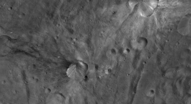 This image from NASA's Dawn spacecraft of asteroid Vesta shows two craters, one that has been named Canuleia and one that has been named Sossia.