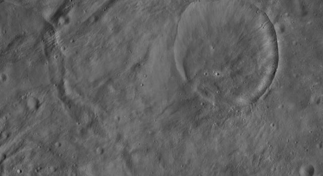 This image from NASA's Dawn spacecraft of asteroid Vesta shows Eusebia crater, which is the large crater in the top right of the image.