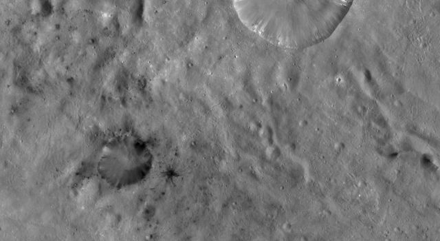 This image from NASA's Dawn spacecraft of asteroid Vesta shows Laelia crater and Sextilia crater, located in Vesta's Sextilia quadrangle, in Vesta's southern hemisphere.