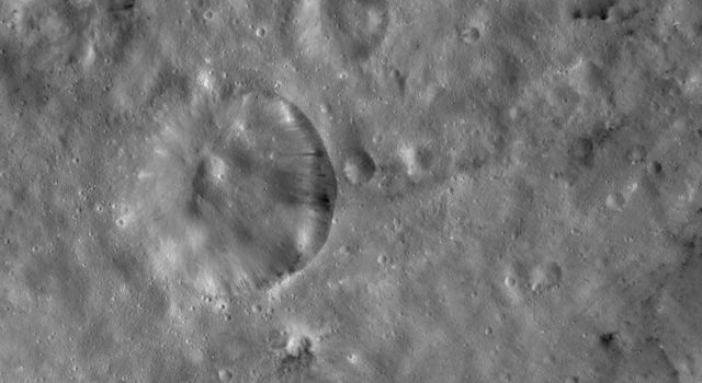 This image from NASA's Dawn spacecraft of asteroid Vesta shows Serena crater, located in the Sextilia quadrangle, southern hemisphere. A mound of material is seen in the center of the crater and many small craters scattered over Serena crater.