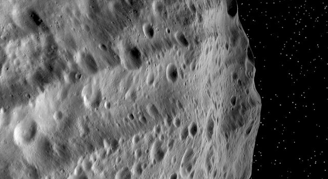 This image from NASA's Dawn mission shows huge grooves on the giant asteroid Vesta that were the result of mega impacts at the south pole.