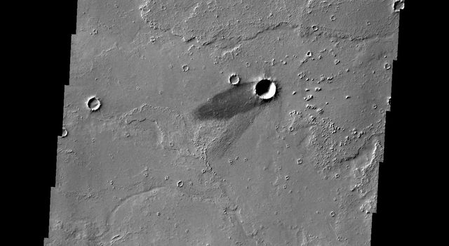 The solitary windstreak in today's image from NASA's 2001 Mars Odyssey spacecraft is located on the volcanic plains of Daedalia Planum. The windstreak appears to represent two different wind directions.