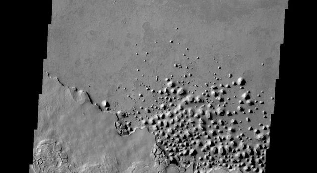 This small region of hills appears to be forming from the fractured material just south of it. This material is the northern extension of Zephyria Planum. This image is from NASA's 2001 Mars Odyssey spacecraft.