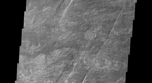 Oti Fossae are paired fractures with a downdropped block [called graben] located on the eastern flank of Arsia Mons as seen by NASA's 2001 Mars Odyssey spacecraft.