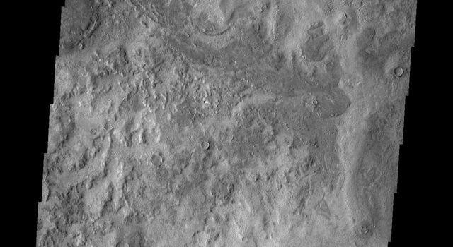 This image from NASA's 2001 Mars Odyssey spacecraft shows two craters located in the northern lowlands.
