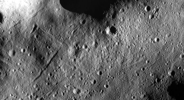 This image from NASA's Dawn spacecraft of asteroid Vesta shows many secondary crater chains on Vesta's surface. This image is located in Vesta's Domitia quadrangle, in Vesta's northern hemisphere.