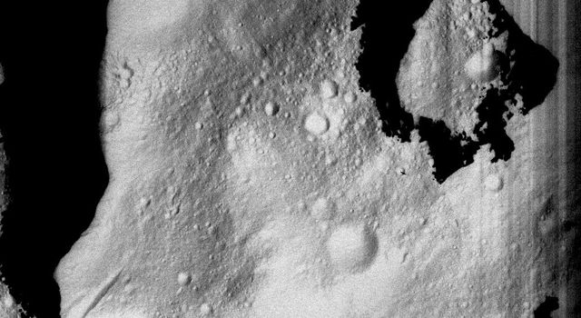 This image from NASA's Dawn spacecraft shows a part of asteroid Vesta's surface reasonably far north into the northern hemisphere which appears washed out because it has been stretched to make features visible that would otherwise be too dark to see.