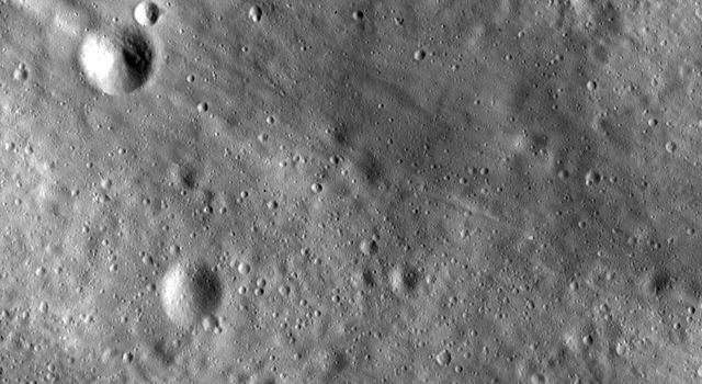 This image from NASA's Dawn spacecraft shows linear grooves and ridges in Vesta's regolith, located in Vesta's Tuccia quadrangle, in asteroid Vesta's southern hemisphere.