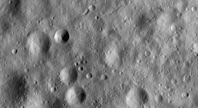 This image from NASA's Dawn spacecraft shows a part of asteroid Vesta's surface that is covered by heavily cratered regolith. Regolith is the fine-grained material that covers most of Vesta's surface.
