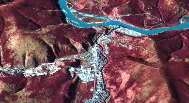 NASA's Terra spacecraft acquired this image of Dawson, Canada. A boom town in 1898, discovery of gold in the Klondike fueled the massive influx of miners, merchants, and other support professions to this town on the Yukon River.