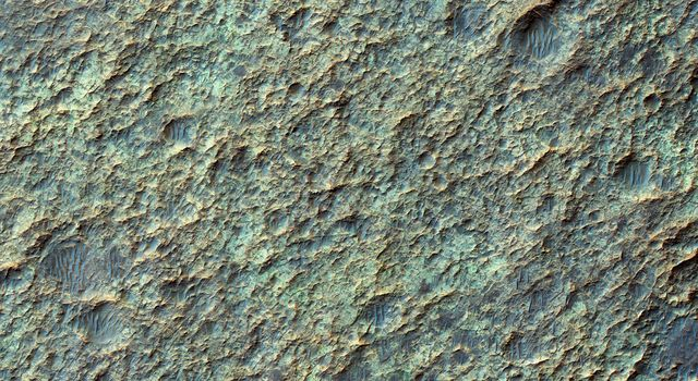 This image from NASA's Mars Reconnaissance Orbiter spacecraft the valley networks on Mars are terrains eroded by flowing water billions of years ago. Where bedrock is well exposed, a variety of colors due to altered minerals and polygonal patterns.