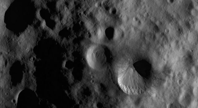 This image from NASA's Dawn spacecraft shows Fabia crater, located in asteroid Vesta's Numisia quadrangle, in Vesta's northern hemisphere.