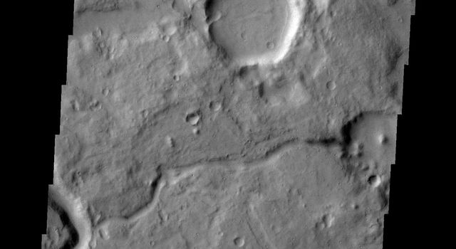 The channels on Mars in this image captured by NASA's Mars Odyssey spacecraft are located between Ares Vallis, a large channel, and Siinka Vallis, a much smaller channel.