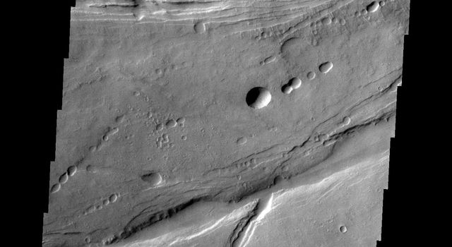 The linear and circular features in this image from NASA's Mars Odyssey spacecraft are all volcanic and are located at the base of the southern flank of Ascraeus Mons on Mars.