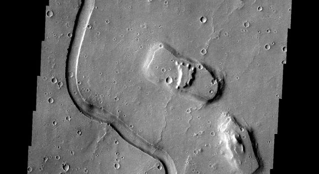 The channel in this image from NASA's 2001 Mars Odyssey spacecraft is part of Hebrus Vallis, located on the western margin of the Elysium volcanic complex.