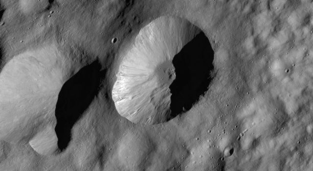 This image from NASA's Dawn spacecraft are located in asteroid Vesta's Floronia quadrangle, in Vesta's northern hemisphere. There are also many hummocky slumps of material around the crater's walls and base.