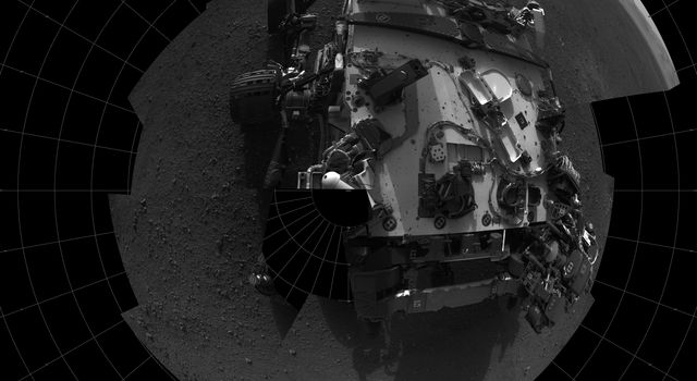 This self-portrait shows the deck of NASA's Curiosity rover from the rover's Navigation camera. The rim of Gale Crater can be seen at upper right.
