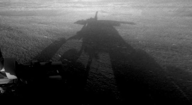 NASA's Mars Exploration Rover Opportunity captured this view of its afternoon shadow stretching into Endeavour Crater during the 3,051st Martian day, or sol, of Opportunity's work on Mars (Aug. 23, 2012).