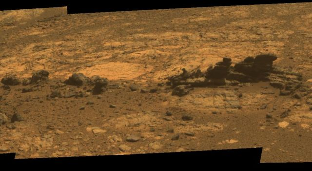 Rock fins up to about 1 foot (30 centimeters) tall dominate this approximate true color scene from the panoramic camera (Pancam) on NASA's Mars Exploration Rover Opportunity.