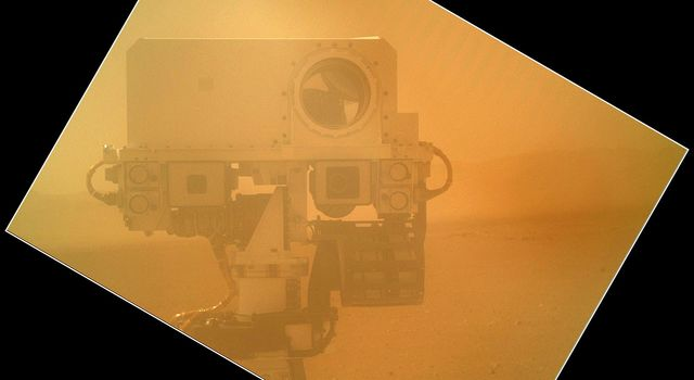 On Sol 32 (Sept. 7, 2012) the Curiosity rover used a camera located on its arm to obtain this self portrait. The MAHLI cover was in the closed position in order to inspect the dust cover.