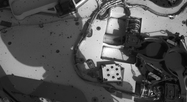 This image from NASA's Curiosity rover shows the inlet covers for the Sample Analysis at Mars instrument as the rover continues to check out its instruments in the first phase after landing.