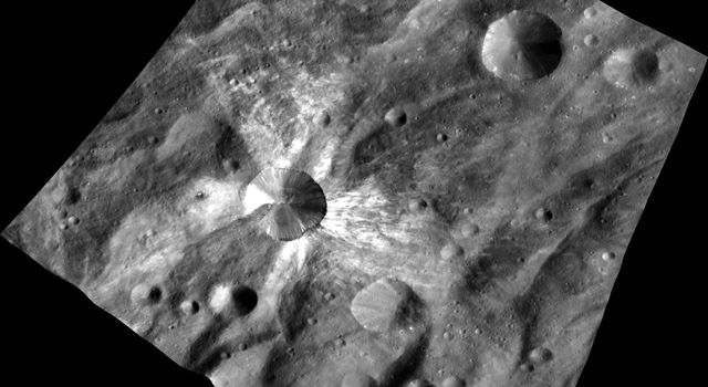 This image from NASA's Dawn spacecraft features the distinctive crater Canuleia on the giant asteroid Vesta. Canuleia, about 6 miles (10 kilometers) in diameter, is distinguished by the rays of bright material that streak out from it.
