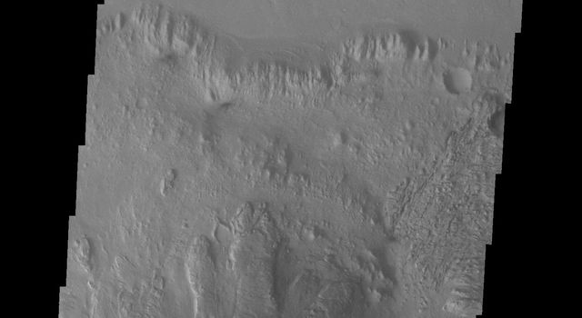 This image from NASA's Mars Odyssey spacecraft shows the northern part of Mt. Sharp and the crater floor between Mt. Sharp and the northern rim of Gale Crater. The layering of Mt. Sharp is visible at the bottom of the image.