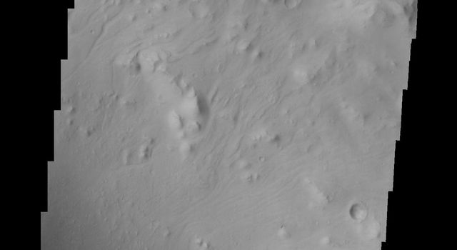 Moving further east, we see more dunes. This image captured by NASA's 2001 Mars Odyssey spacecraft shows more of the crater rim and the crater floor seen in the image is not as smooth as in other parts of the crater.