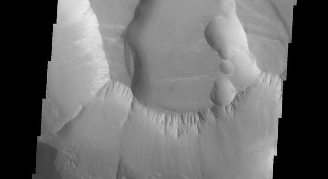 This image captured by NASA's 2001 Mars Odyssey spacecraft shows several small landslide deposits in Noctis Labyrinthus.