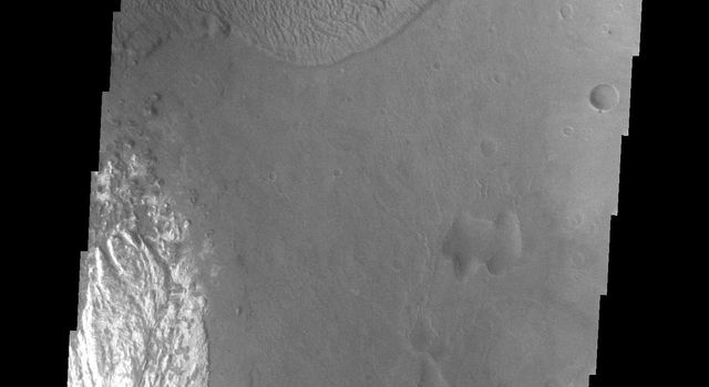 This image captured by NASA's 2001 Mars Odyssey spacecraft shows a landslide deposit which flowed towards the floor of Ganges Chasma.