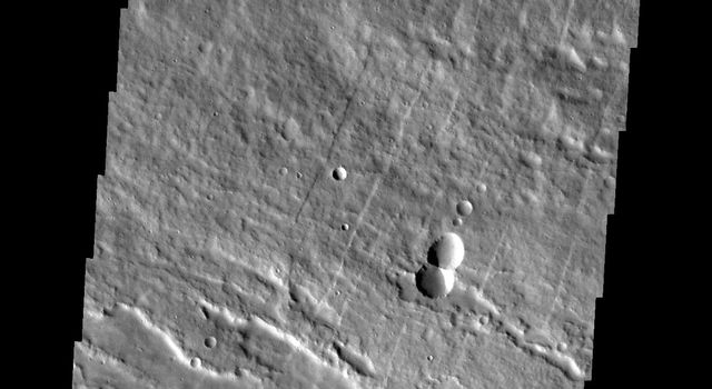 Image captured by NASA's 2001 Mars Odyssey spacecraft shows the eastern flank of Arsia Mons midway between the summit of the volcano and the surrounding plains.