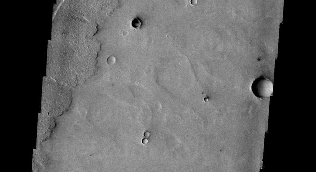 The parallel sides and low interior seen in this image from NASA's 2001 Mars Odyssey spacecraft are faults and down-dropped material between the faults. This tectonic feature is called a graben. The graben in this image is located in Daedalia Planum.