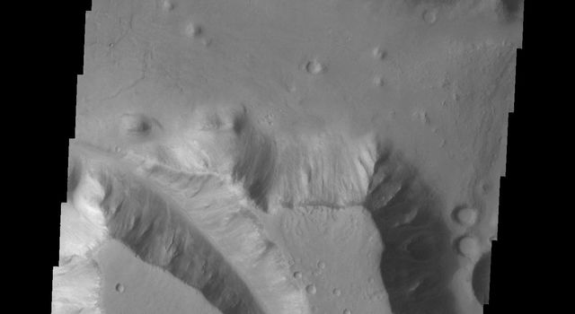 A very large valley (mega gully) cuts through part of this mesa in Chryse Chaos on Mars in this image as seen by NASA's 2001 Mars Odyssey spacecraft.