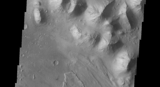 The landslide deposits in this image captured by NASA's 2001 Mars Odyssey spacecraft are located in Baetis Chaos.