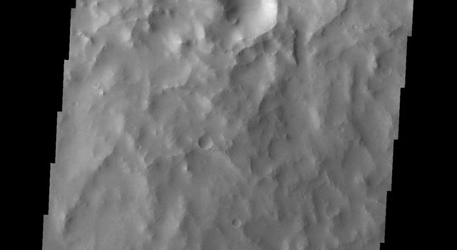 The landslide deposit in this image from NASA's 2001 Mars Odyssey spacecraft is located in an unnamed crater in Xanthe Terra.