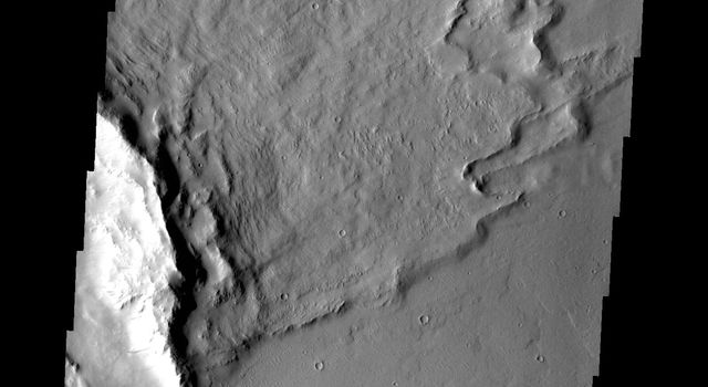 'Butterfly' ejecta is the name given when a crater has two lobes of ejecta on opposite sides, with little or no ejecta between the lobes. This image is from NASA's 2001 Mars Odyssey spacecraft.