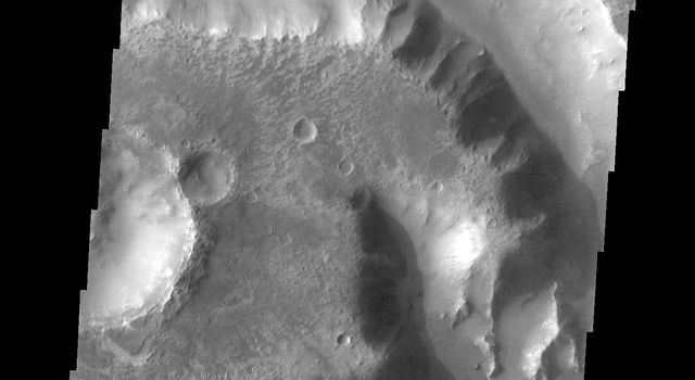 This image from NASA's 2001 Mars Odyssey spacecraft shows a portion of Her Desher Vallis.