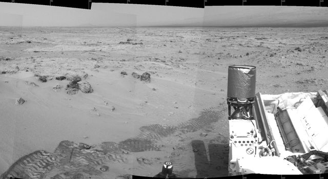 NASA's Mars rover Curiosity drove 6.2 feet (1.9 meters) during the 100th Martian day, or sol, of the mission (Nov. 16, 2012). The view spans from north at the left to south-southeast at the right. It is presented in a cylindrical projection.