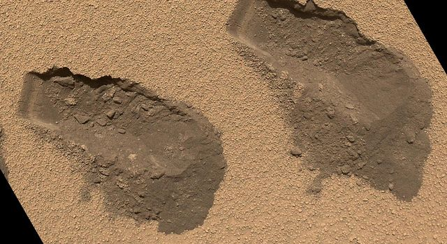 This is a view of the third (left) and fourth (right) trenches made by the 1.6-inch-wide (4-centimeter-wide) scoop on NASA's Mars rover Curiosity in October 2012 and shows some of the details regarding the properties of the 'Rocknest' wind drift sand.