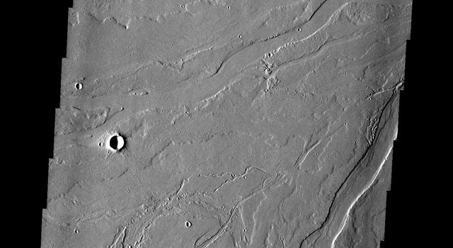 This image from NASA's 2001 Mars Odyssey spacecraft shows the Tharsis plains contains numerous channels, which were likely created by the flow of lava.